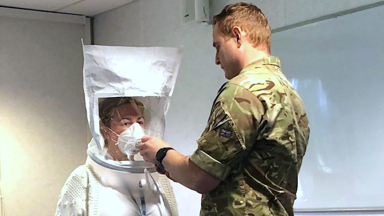 Two air force dentists fit testing PPE