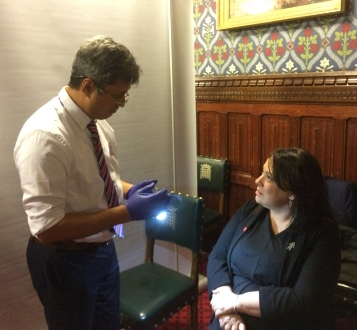 Paula Sheriff MP discussing the importance of regular mouth checks with Dr Patel