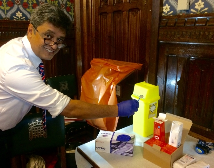 Dr Jayesh Patel prepares to deliver mouth cancer checks to MPs