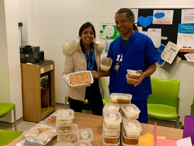 A&E doctor at Northwick Park Hospital, London is happy to see hot meals and freshly baked cake.