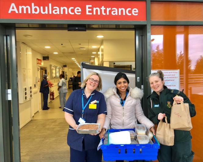 A&E nurse and paramedic welcome another food delivery to Northwick Park Hospital, London.
